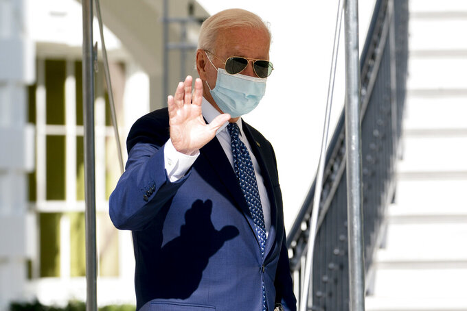 President Joe Biden waves as he walks towards Marine One on the South Lawn of the White House in Washington, Monday, Sept. 20, 2021, for a short trip to Andrews Air Force Base, Md., and then on to New York ahead of a United Nations General Assembly meeting. (AP Photo/Andrew Harnik)
