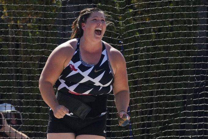 DeAnna Price reacts after setting a new American record during the finals of the women's hammer throw at the U.S. Olympic Track and Field Trials Saturday, June 26, 2021, in Eugene, Ore. (AP Photo/Ashley Landis)