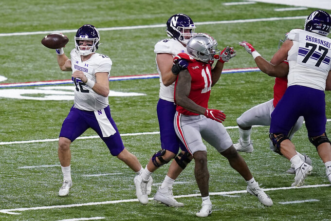 Northwestern quarterback Peyton Ramsey (12) drops back to pass during the first half of the Big Ten championship NCAA college football game against Ohio State, Saturday, Dec. 19, 2020, in Indianapolis. (AP Photo/Darron Cummings)