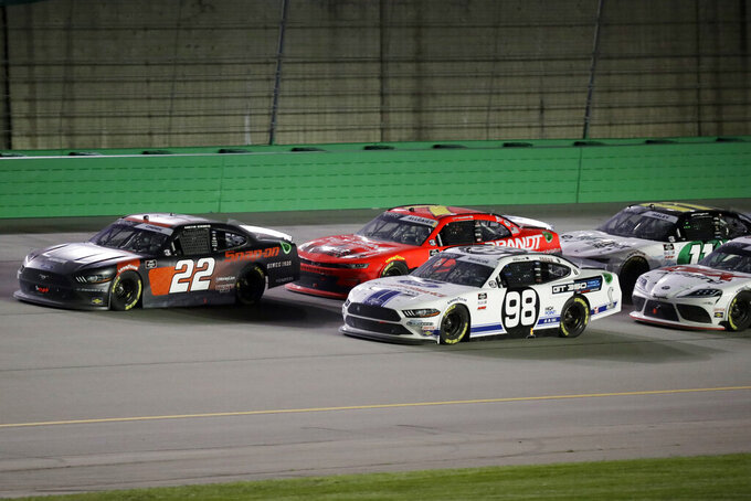 Austin Cindric (22) heads to the finish ahead of Chase Briscoe (98) during a NASCAR Xfinity Series auto race Thursday, July 9, 2020, in Sparta, Ky. (AP Photo/Mark Humphrey)