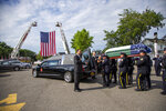 Police Department pallbearers carry retired New York Police Department Detective Luis Alvarez's casket to an awaiting hearse so he can be driven to his his funeral services in the Queens borough of New York, Wednesday, July 3, 2019. Alvarez died Saturday, June 29, 2019 after a three-year battle with colorectal cancer. He attributed his illness to the three months he spent digging through rubble at the World Trade Center's twin towers after the 2001 terrorist attacks. (Howard Schnapp/Newsday via AP)