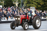 A man on a tractor takes part in a parade to mark the Independence Day in downtown Skopje, North Macedonia, Wednesday, Sept. 8, 2021. North Macedonia is celebrating Wednesday the 30th anniversary since its independence from former Yugoslavia. (AP Photo/Boris Grdanoski)