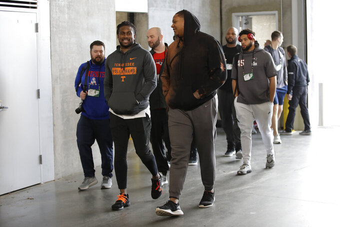 New England Patriots' Cordarrelle Patterson, center, left, and Trent Brown, center right, arrive for a NFL football walkthrough, Saturday, Feb. 2, 2019, in Atlanta, ahead of Super Bowl 53 against the Los Angeles Rams. (AP Photo/Matt Rourke)