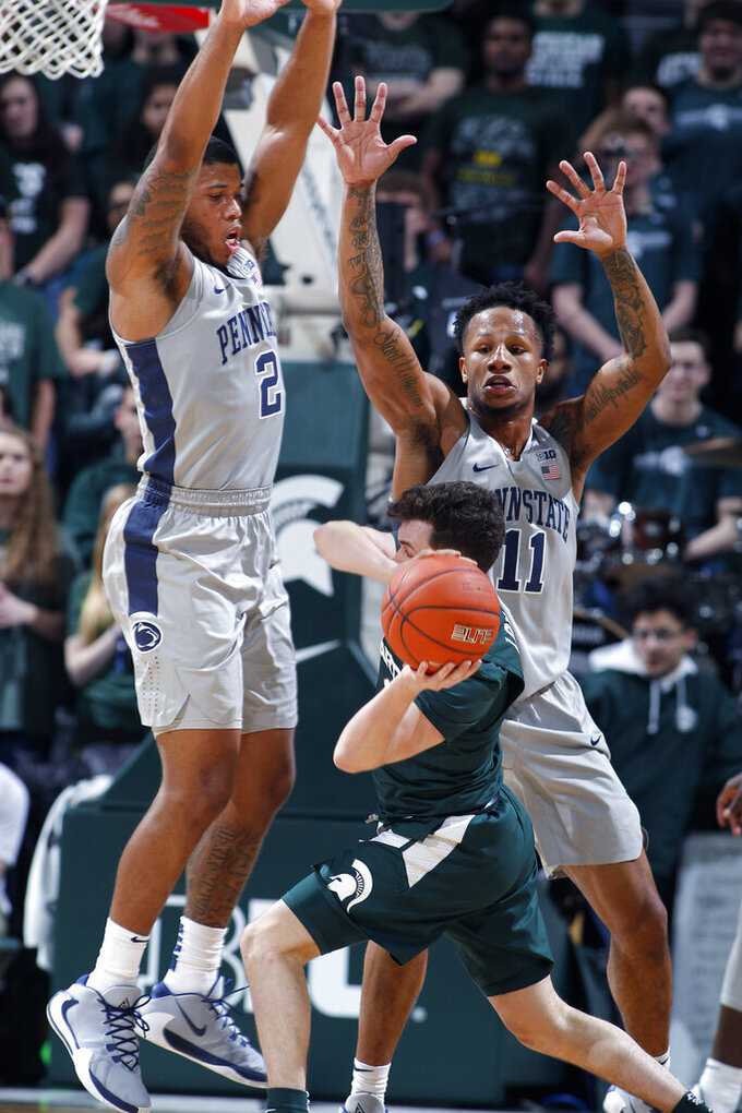 Penn State's Myles Dread, left, and Lamar Stevens (11) pressure Michigan State's Foster Loyer during the first half of an NCAA college basketball game Tuesday, Feb. 4, 2020, in East Lansing, Mich. (AP Photo/Al Goldis)