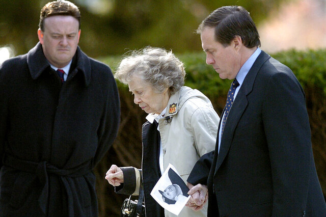 FILE - In this Nov. 23, 2005, file photo, New England Patriots head coach Bill Belichick, right, escorts his mother Jeannette as they leave the Naval Academy Chapel in Annapolis, Md., where they attended a funeral service for his father Steve Belichick. Jeannette Belichick died Monday, Sept. 14, 2020, from natural causes in Annapolis, Md. She was 98. (AP Photo/Matthew S. Gunby, File)