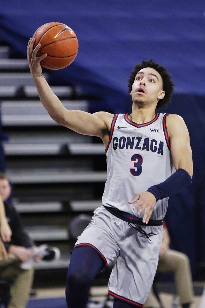 Gonzaga guard Andrew Nembhard shoots during the second half of the team's NCAA college basketball game against Northwestern State in Spokane, Wash., Tuesday, Dec. 22, 2020. Gonzaga won 95-78. (AP Photo/Young Kwak)