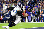 Tennessee Titans strong safety Kenny Vaccaro (24) defends as Baltimore Ravens tight end Hayden Hurst (81) makes a touchdown catch during the second half of an NFL divisional playoff football game, Saturday, Jan. 11, 2020, in Baltimore. (AP Photo/Nick Wass)
