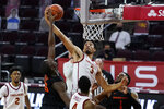 Southern California forward Isaiah Mobley (3) and Oregon State forward Dearon Tucker, second from left, reach for a rebound during the first half of an NCAA college basketball game Thursday, Jan. 28, 2021, in Los Angeles. (AP Photo/Ashley Landis)
