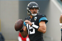 Jacksonville Jaguars quarterback Gardner Minshew looks for a receiver against the Los Angeles Chargers during the first half of an NFL football game, Sunday, Dec. 8, 2019, in Jacksonville, Fla. (AP Photo/Stephen B. Morton)