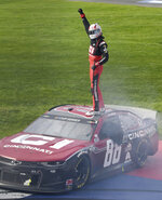 Alex Bowman celebrates on the roof of his race car after winning a NASCAR Cup Series auto race Sunday, March 1, 2020 in Fontana, Calif. (AP Photo/Will Lester)
