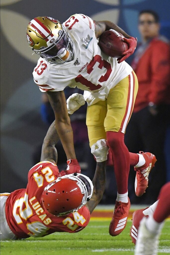 Kansas City Chiefs Jordan Lucas, left, tackles San Francisco 49ers Richie James during the second half of the NFL Super Bowl 54 football game Sunday, Feb. 2, 2020, in Miami Gardens, Fla. (AP Photo/Mark J. Terrill)