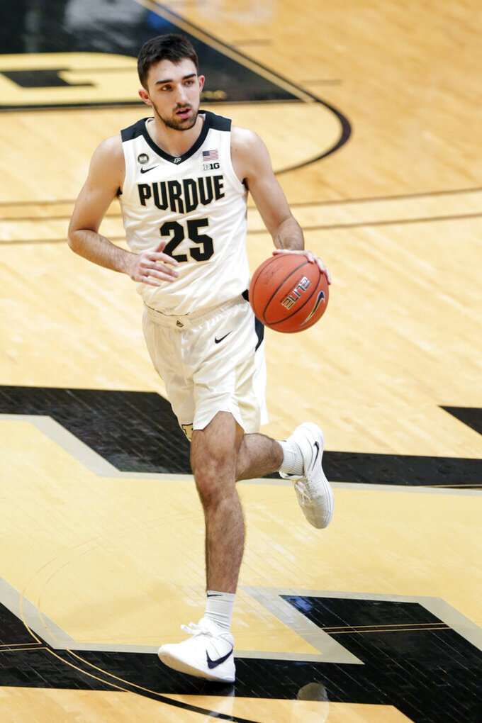 Purdue guard Ethan Morton (25)  moves the ball against Oakland during the first half of an NCAA college basketball game Tuesday, Dec. 1, 2020 in West Lafayette, Ind. (Nikos Frazier/Journal & Courier via AP)