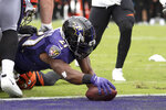 Baltimore Ravens running back Mark Ingram (21) dives in for a touchdown on a run against the Cincinnati Bengals during the first half of a NFL football game Sunday, Oct. 13, 2019, in Baltimore. (AP Photo/Nick Wass)