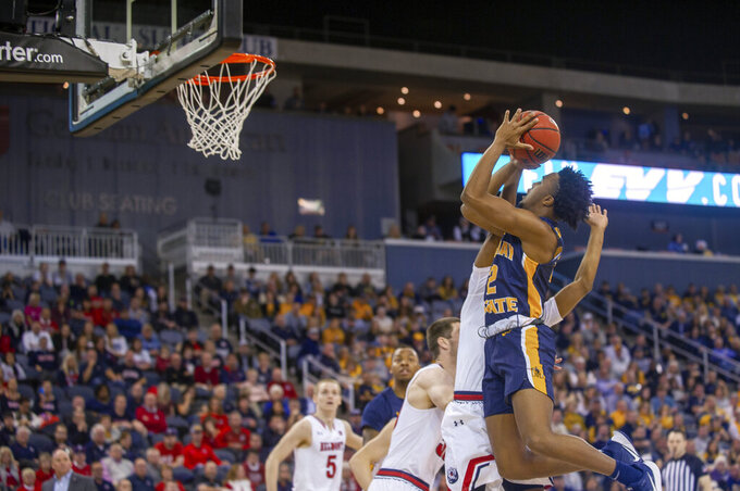 Murray State's Chico Carter (2) goes up for a basket in the first half against Belmont in an NCAA college basketball game for the championship of the Ohio Valley Conference men's tournament Saturday, March 7, 2020, in Evansville, Ind. (AP Photo/Daniel R. Patmore)