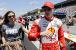 "Josef Newgarden walks with his fiancée Ashley Welsh after he qualified for the Indianapolis 500 IndyCar auto race at Indianapolis Motor Speedway, Saturday, May 18, 2019, in Indianapolis. Welsh joined some of the other drivers' significant others in wearing T-shirts that said, ""Not YOUR Body, Not YOUR Choice."" Indiana is among a handful of states moving to restrict abortions in the hopes that the U.S. Supreme Court will overturn its 1973 decision in Roe. vs. Wade. (AP Photo/Darron Cummings)"