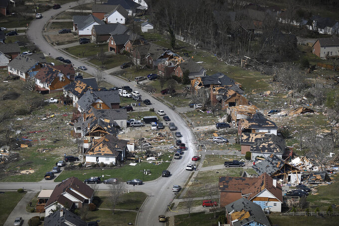 This Tuesday, March 3, 2020 aerial photo shows the Hermitage neighborhood after a tornado ripped through Nashville, Tenn. (George Walker IV/The Tennessean via AP)