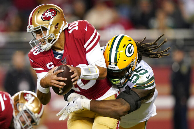 Green Bay Packers outside linebacker Za'Darius Smith (55) sacks San Francisco 49ers quarterback Jimmy Garoppolo (10) during the first half of an NFL football game in Santa Clara, Calif., Sunday, Nov. 24, 2019. (AP Photo/Tony Avelar)