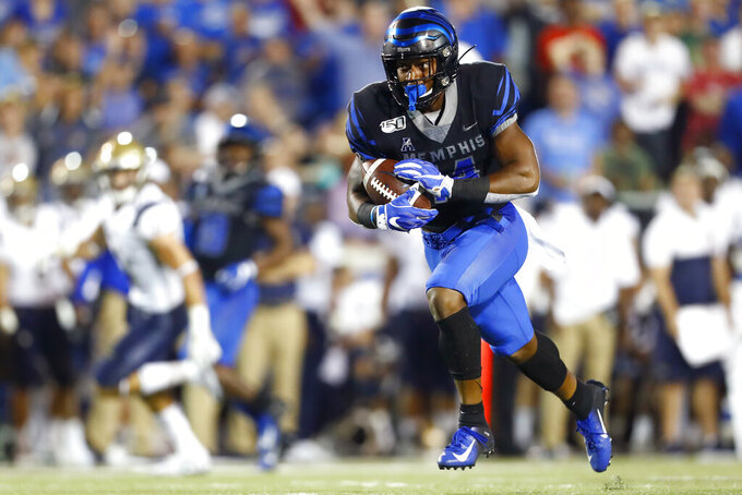 Memphis wide receiver Antonio Gibson runs with a reception on the way to a 73-yard touchdown against Navy during an NCAA college football game Thursday, Sept. 26, 2019, in Memphis, Tenn. (Joe Rondone/The Commercial Appeal via AP)