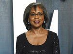 """FILE - In this Feb. 9, 2020, file photo, Anita Hill arrives at the Vanity Fair Oscar Party in Beverly Hills, Calif. Hill, who essentially introduced sexual harassment to the public in 1991, says """"the conversation has changed"""" as a result of #MeToo. (Photo by Evan Agostini/Invision/AP, File)"""