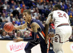 Auburn guard Samir Doughty drives past South Carolina forward Keyshawn Bryant (24) in the first half of an NCAA college basketball game at the Southeastern Conference tournament Friday, March 15, 2019, in Nashville, Tenn. (AP Photo/Mark Humphrey)