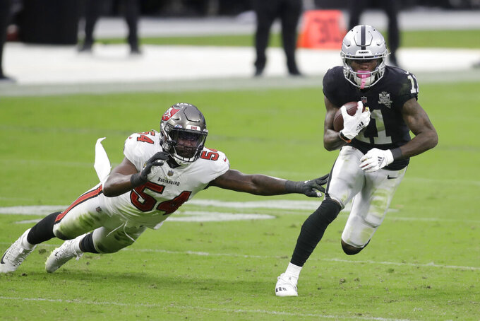 Las Vegas Raiders wide receiver Henry Ruggs III (11) runs by Tampa Bay Buccaneers inside linebacker Lavonte David (54) during the second half of an NFL football game, Sunday, Oct. 25, 2020, in Las Vegas. (AP Photo/Isaac Brekken)