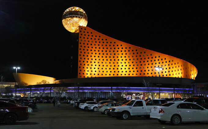 In this Dec. 18, 2018 photo, the Golden Moon Hotel and Casino, part of the Pearl River Resort is lit in Philadelphia, Miss.  The sports book owned by the Mississippi Band of Choctaw Indians is the first to open on tribal lands outside of Nevada following a U.S. Supreme Court ruling earlier this year, a no-brainer business decision given the sports fans among its gambling clientele. (AP Photo/Rogelio V. Solis)