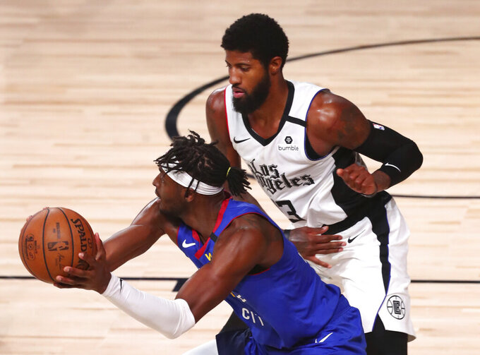 Denver Nuggets forward Jerami Grant (9) is defended by Los Angeles Clippers' guard Paul George (13) during the second half of an NBA basketball game Wednesday, Aug. 12, 2020, in Lake Buena Vista, Fla. (Kim Klement/Pool Photo via AP)