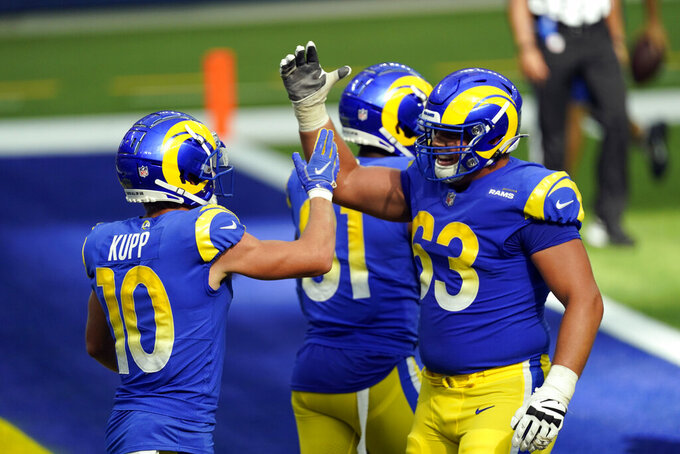 Los Angeles Rams wide receiver Cooper Kupp (10) celebrates his touchdown catch with Austin Corbett (63) during the second half of an NFL football game against the New York Giants Sunday, Oct. 4, 2020, in Inglewood, Calif. (AP Photo/Ashley Landis)