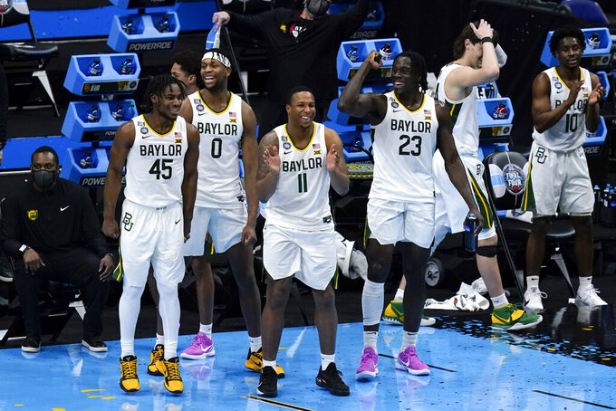 Baylor players celebrate at the end of a men's Final Four NCAA college basketball tournament semifinal game against Houston, Saturday, April 3, 2021, at Lucas Oil Stadium in Indianapolis. Baylor won 78-59. (AP Photo/Michael Conroy)