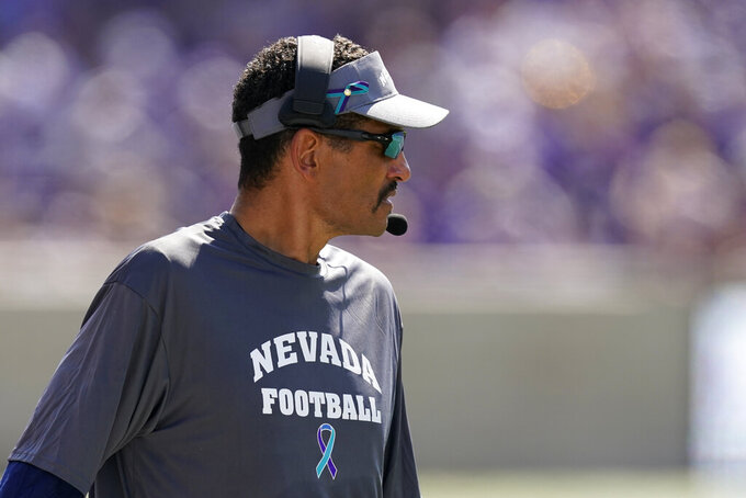 Nevada head coach Jay Norvell watches during the first half of an NCAA college football game against Kansas State Saturday, Sept. 18, 2021, in Manhattan, Kan. (AP Photo/Charlie Riedel)