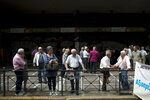 Pensioners take part in a protest outside the Labor ministry in central Athens, on Wednesday, May 16, 2018. The government has repeatedly cut pensions as part of the country's three international bailouts. More cuts are planned in 2019. (AP Photo/Petros Giannakouris)