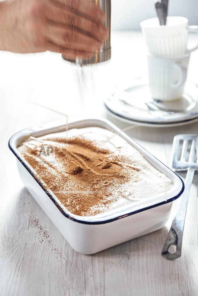 Tiramisu with coconut and cashew cream, cocoa shaker
