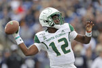 South Florida quarterback Jordan McCloud throws a pass against Navy during the first half of an NCAA college football game, Saturday, Oct. 19, 2019, in Annapolis. (AP Photo/Julio Cortez)