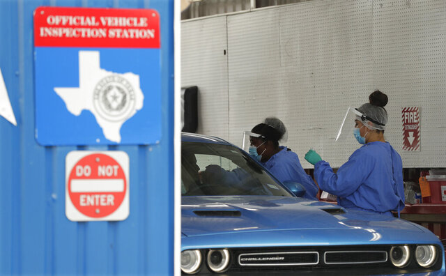 COVID-19 antibody testing and diagnostic testing are administered at a converted vehicle inspection station, Tuesday, July 7, 2020, in San Antonio. Local officials across Texas say their hospitals are becoming increasingly stretched and are in danger of becoming overrun as cases of the coronavirus surge. (AP Photo/Eric Gay)