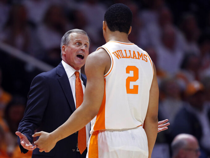 Tennessee coach Rick Barnes talks with forward Grant Williams (2) during the second half of an NCAA college basketball game against Florida on Saturday, Feb. 9, 2019, in Knoxville, Tenn. Tennessee won 73-61. (AP photo/Wade Payne)