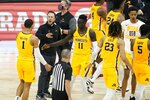 Minnesota head coach Richard Pitino greets players during the second half of an NCAA college basketball game against Northwestern at the Big Ten Conference tournament, Wednesday, March 10, 2021, in Indianapolis. (AP Photo/Darron Cummings)