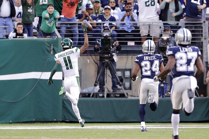 New York Jets' Robby Anderson (11) reacts as he scores a touchdown during the first half of an NFL football game against the Dallas Cowboys, Sunday, Oct. 13, 2019, in East Rutherford, N.J. (AP Photo/Frank Franklin II)