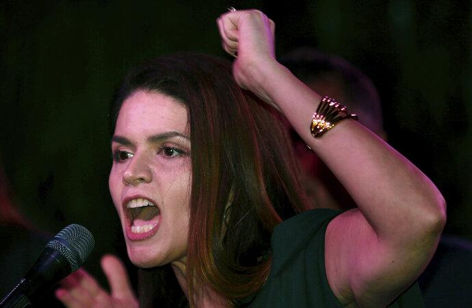 Mayor-elect Regina Romero leads the crowd of well-wishers in a