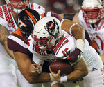 North Carolina State's Bailey Hockman, front, is sacked by Virginia Tech's Justus Reed during an NCAA college football game Saturday, Sept. 26, 2020, in Blacksburg, Va. (Matt Gentry/The Roanoke Times via AP, Pool)