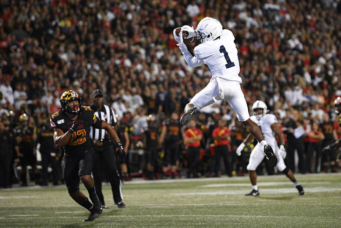 Penn State wide receiver KJ Hamler (1) makes a catch against Maryland linebacker Isaiah Davis (22) during the first half of an NCAA college football game, Friday, Sept. 27, 2019, in College Park, Md. (AP Photo/Nick Wass)