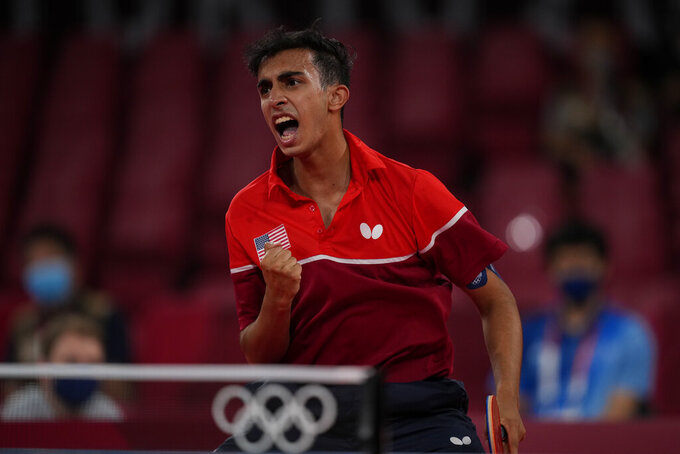 Nikhil Kumar, of United State reactss during men's table tennis singles preliminary round match against Mongolia's Enkhbat Lkhagvasuren at the 2020 Summer Olympics, Saturday, July 24, 2021, in Tokyo. (AP Photo/Kin Cheung)