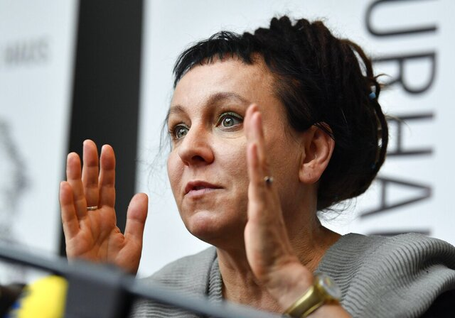 "FILE - In this Friday, Oct. 11, 2019 file photo, Polish writer and Nobel Prize winner Olga Tokarczuk reacts to the media during a press conference in Duesseldorf, Germany. Nobel Prize-winning writer Olga Tokarczuk has declined an honorary citizenship from the region of Poland where she lives because she would have had to share the honor with a Roman Catholic bishop who has made hostile comments about the LGBT community. Tokarczuk said in a tweet Friday, Sept. 25 that while she appreciated being considered, she ""sadly"" couldn't accept Lower Silesia's honorary citizenship. (AP Photo/Martin Meissner, file)"