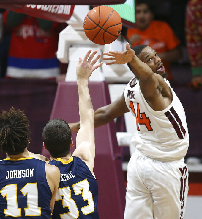 Chattanooga's Stefan Kenic (33) shoots past the defense of Virginia Tech's P.J. Horne (14) in the second half of an NCAA college basketball game, Wednesday, Dec. 11, 2019, in Blacksburg, Va. (Matt Gentry/The Roanoke Times via AP)