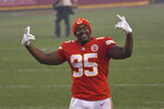 Kansas City Chiefs defensive tackle Chris Jones celebrates after an NFL divisional round football game against the Cleveland Browns, Sunday, Jan. 17, 2021, in Kansas City. The Chiefs won 22-17. (AP Photo/Reed Hoffmann)