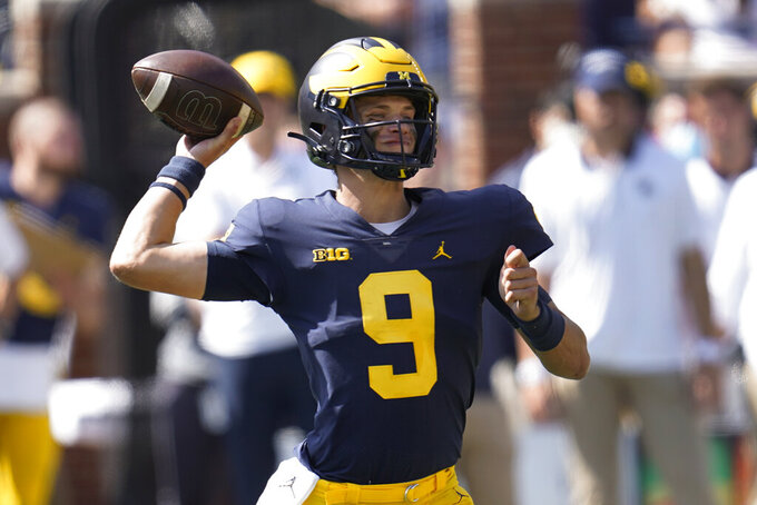Michigan quarterback J.J. McCarthy throws against Northern Illinois in the second half of a NCAA college football game in Ann Arbor, Mich., Saturday, Sept. 18, 2021. (AP Photo/Paul Sancya)