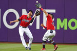 Cleveland Indians' Bobby Bradley, right, avoids colliding with Bradley Zimmer to catch a ball hit by Houston Astros' Taylor Jons in the fourth inning of a baseball game,Saturday, July 3, 2021, in Cleveland. (AP Photo/David Dermer)