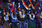 FILE - In this Feb. 8, 2020 file photo, confetti showers Luis Arce, center, Bolivian presidential candidate for the Movement Towards Socialism Party, or MAS, and running mate David Choquehuanca, second left, during their opening campaign rally, in El Alto, Bolivia. Arce was named by exiled former President Evo Morales as his party's presidential candidate. (AP Photo/Juan Karita, File)