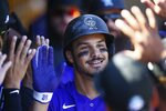FILE - In this March 3, 2020, file photo, Colorado Rockies' Nolan Arenado smiles as he celebrates his two-run home run against the Chicago Cubs during the first inning of a spring training baseball game Tuesday, March 3, 2020, in Scottsdale, Ariz. Sixty-five players would earn at least $100,000 each time their team wins or loses if the pandemic-delayed major league season get under way, according to an analysis of their contracts by The Associated Press. Arenado is scheduled to earn $216,049 per game. (AP Photo/Ross D. Franklin, File)