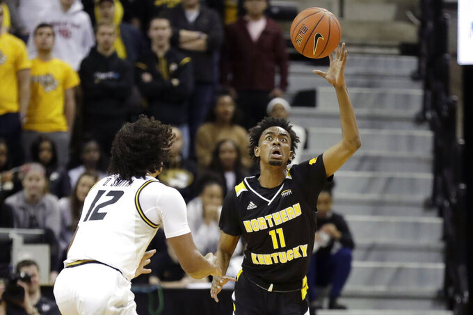 Northern Kentucky's Jalen Tate (11) reaches for the ball as Missouri's Dru Smith (12) watches during the first half of an NCAA college basketball game Friday, Nov. 8, 2019, in Columbia, Mo. (AP Photo/Jeff Roberson)