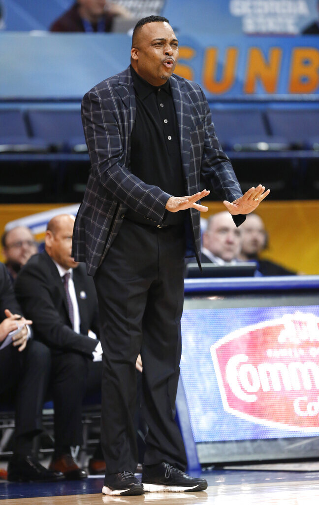 Georgia State coach Ron Hunter reacts to a call during the first half of the team's NCAA college basketball game against Texas-Arlington for the championship of the Sun Belt Conference men's tournament  in New Orleans, Sunday, March 17, 2019. Georgia State won 73-64. (AP Photo/Tyler Kaufman)